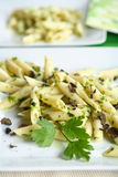 Pasta with truffle. And dainty cut parsley Stock Photography