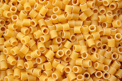 Pasta tubes background Royalty Free Stock Images