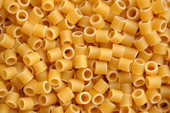 Pasta tubes background pattern stock photos