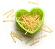 Pasta tubes in heart form Stock Photos