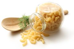Pasta tubes in jar and spoon Royalty Free Stock Photos