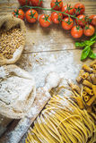Pasta tubes and tagliatelle with integral flour. Stock Photography