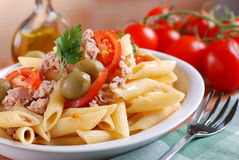 Pasta with tuna and olives. Pasta with tuna, olives and tomato on white plate Royalty Free Stock Image