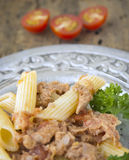 Pasta with tuna, parsley and tomatoes in silver plate Stock Photo