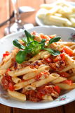Pasta with tune. Cooked pasta with tune,  tomatoes and herbs Royalty Free Stock Images