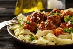 Pasta with turkey meatballs in tomato sauce. Stock Photos