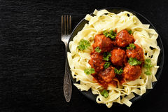 Pasta with turkey meatballs in tomato sauce. Royalty Free Stock Image