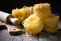 Pasta. Uncooked pasta on wooden surface Royalty Free Stock Photo