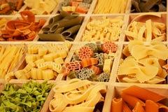Pasta variation. Various colorfull pasta sorts detail in wooden box royalty free stock photos
