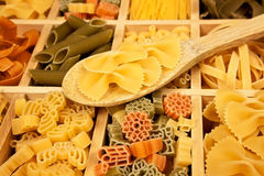 Pasta variation. Different pasta sorts arranged in wooden box with wooden spoon stock photo