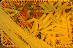 Pasta variation in a brown basket . Royalty Free Stock Photos