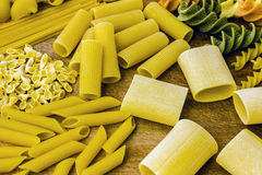 Pasta Variation on a Wooden Cutting Board. Different types of pasta on a wooden cutting board. Studio shot Royalty Free Stock Photo
