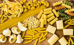 Pasta Variations on a Cutting Board. Studio shot of different types of pasta on a wooden cutting board Stock Photography