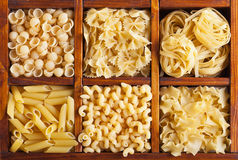 Pasta variety. In wooden compartmented box - top view Royalty Free Stock Images