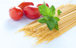 Pasta of various sizes with tomato and basil Stock Photo