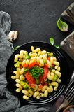 Pasta with vegetables. On a black background. Top view. Free space for your text royalty free stock photos