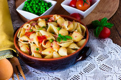 Pasta with vegetables in ceramic clay pot Royalty Free Stock Image