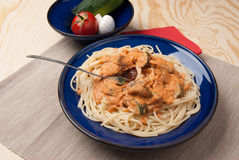 Pasta with vegetables and cream sauce Stock Images