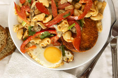 Pasta with vegetables and eggs. Stock Photos