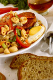 Pasta with vegetables, eggs and burgers. Royalty Free Stock Photo