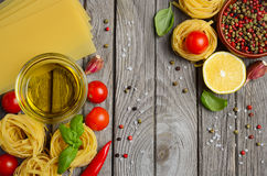 Pasta, vegetables, herbs and spices for Italian food Royalty Free Stock Images