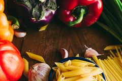 Pasta and vegetables ingredients stock images