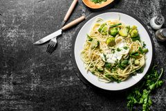 Pasta with vegetables on a plate and spices with parsley royalty free stock photo