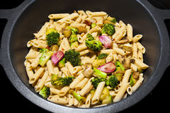 PASTA WITH VEGETABLES. Pot with PENNE PASTA WITH A VEGETABLES Stock Images