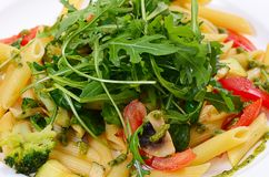 Pasta with vegetables and salad Stock Photo