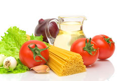 Pasta, vegetables and sunflower oil on a white Stock Image