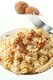 Pasta with a walnut Stock Images