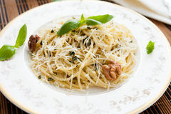Pasta with walnut pesto and parmesan Stock Photos