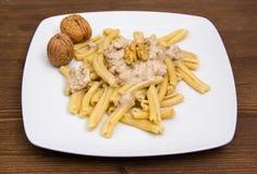 Pasta with walnut pesto on wood Stock Photography
