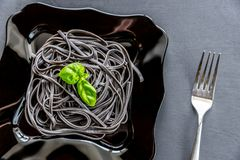 Pasta with wheat germ and black cuttlefish ink Stock Image