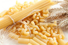 Pasta and wheat spikelets. Mature ears of wheat Royalty Free Stock Image