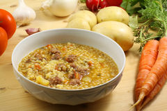 Pasta whit potato soup and meatballs Stock Image