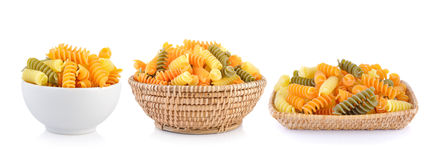 Pasta in white bowl and basket royalty free stock images
