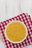 Pasta on white bowl on napkin on white background Stock Image