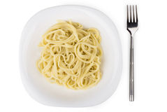 Pasta in white glass plate and fork Royalty Free Stock Image