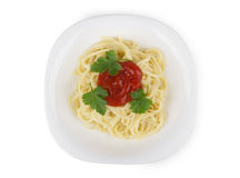 Pasta in white glass plate with tomato ketchup and parsley Royalty Free Stock Image