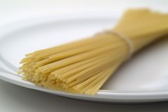 Pasta on White Plate. Close-up of raw pasta on white plate stock photo
