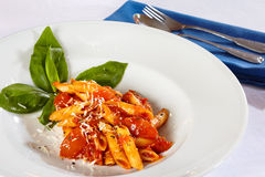Pasta on white plate with tomato sauce. Stock Photo