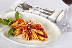 Pasta on white plate with tomato sauce. Royalty Free Stock Photo