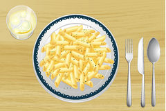Pasta and white sauce in a dish Stock Image