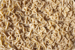 Pasta. Wholemeal farfalle bio pasta background Royalty Free Stock Photography