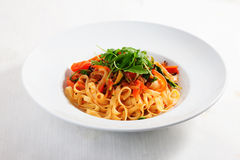 Pasta With Vegetables, Tomatoes, Zucchini, Peppers, Isolated On White Background Tomato Sauce Round Plate Menu