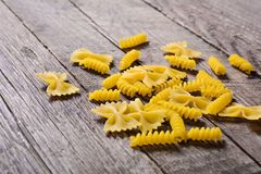 Pasta on wood table Royalty Free Stock Photography