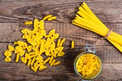 Pasta on wood table Stock Images
