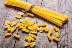 Pasta on wood table Royalty Free Stock Photos
