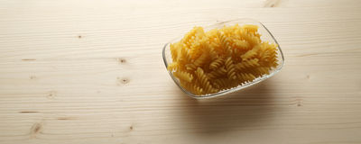 Pasta on wooden background  - banner / header edition. Pasta on wooden background  - banner/header edition Stock Photography